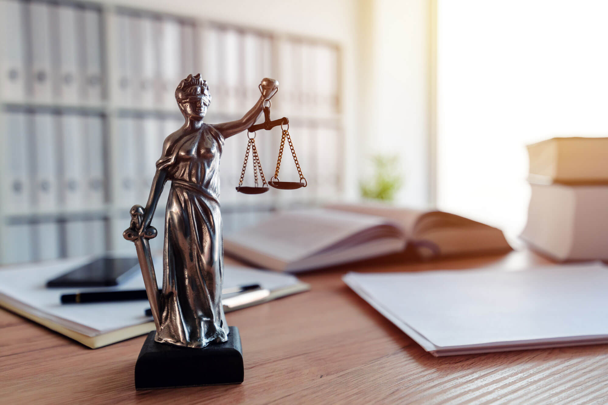 Photo of a Statue of Scales of Justice