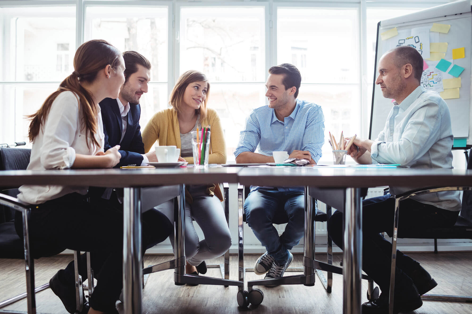 Photo of a Group of People sitting at a table